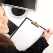 Businesswoman with clipboard - Foto Stock