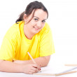 Fat woman writing on blank card — Stock Photo