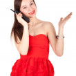 Calling woman in red dress - Stockfoto