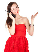 Calling woman in red dress — Stock Photo