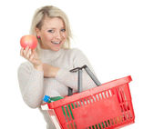Woman with shopping basket — Stock fotografie