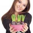 Woman with flowers in flowerpot — Stock Photo
