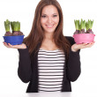 Stock Photo: Woman with flowers in flowerpot