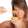 Young woman with honey — Stock Photo #5170032