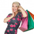 Young woman & coloured shopping bags — Stock Photo #5208093