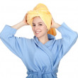 Woman in bathrobe and towel on head — Stock Photo #5208145