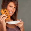Young woman and tasty cake — Stok fotoğraf