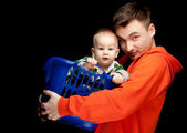 Happy young father and baby boy — Stok fotoğraf