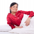 Beautiful young woman in bed - Stok fotoraf