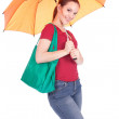 Woman with shopping bag and umbrella - Stok fotoraf