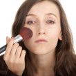 Young woman with powder brush — Stock Photo #5291524