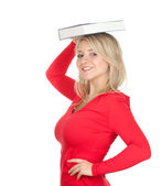 Woman with book on head — Stock Photo