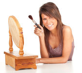 Young woman with powder brush — Stock Photo