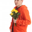 Young man with roses — Stock Photo
