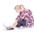 Young girl working on laptop — Stock Photo