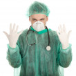 Doctor pulling on surgical gloves — Stock Photo
