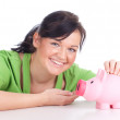 Royalty-Free Stock Photo: Girl with pink piggy bank