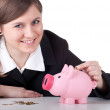 Stock Photo: Businesswoman with piggy bank