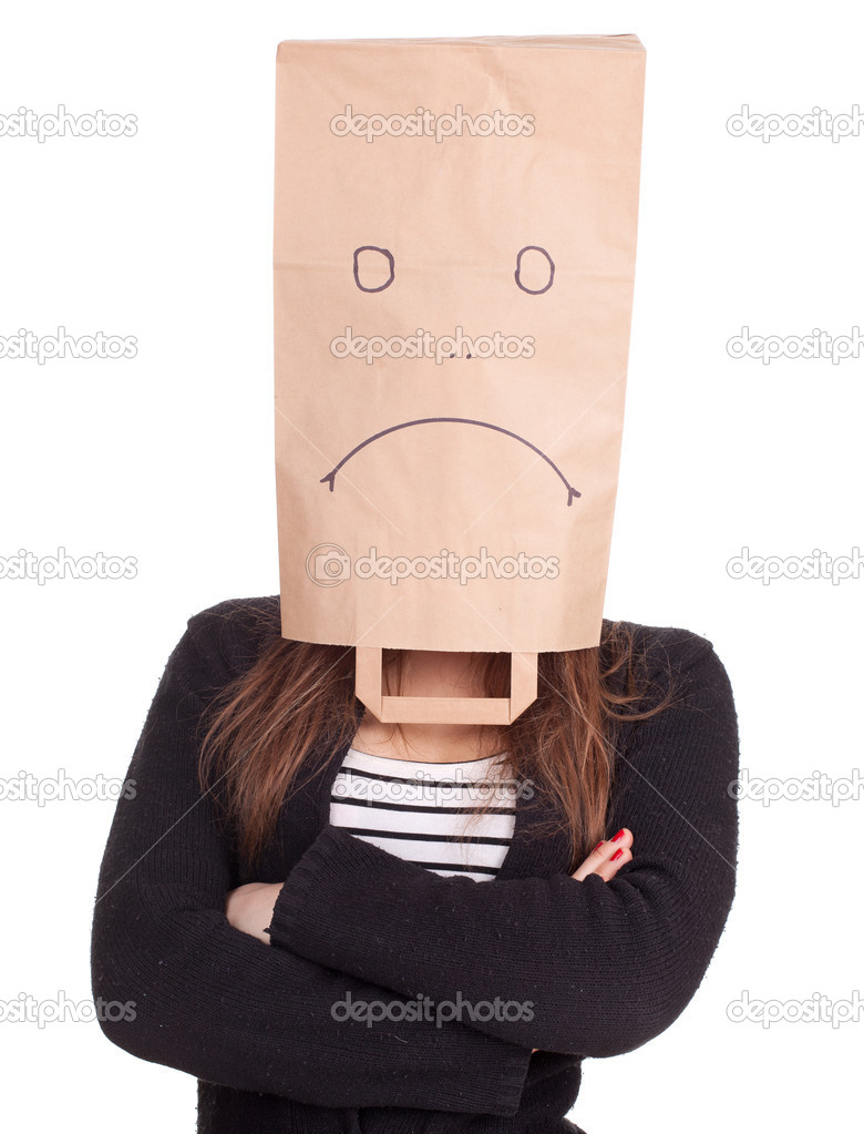 Young woman in sad ecological paper bag on head with crossed arms, series  Stock Photo #5365806