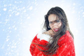 Happy female Santa in snowstorm — Stock Photo