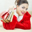 Stock Photo: Female Santa with gift