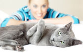 Cat and woman — Stock Photo