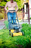 Man cutting the grass with the mower — Stock Photo