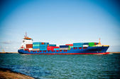 Container ship coming into port — Stock Photo
