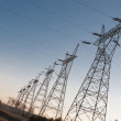 Pylon and transmission power line in sunset — Stock Photo