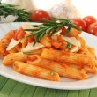 Penne with tomato sauce and Parmesan - Stock Photo