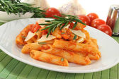 Penne with tomato sauce and Parmesan — Stock Photo