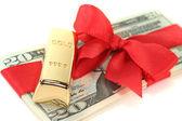 Gold bars on dollar bills — Stock Photo