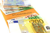 Study book with euro notes — Stock Photo