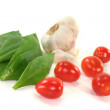 Wild garlic with tomatoes and garlic - Stock Photo