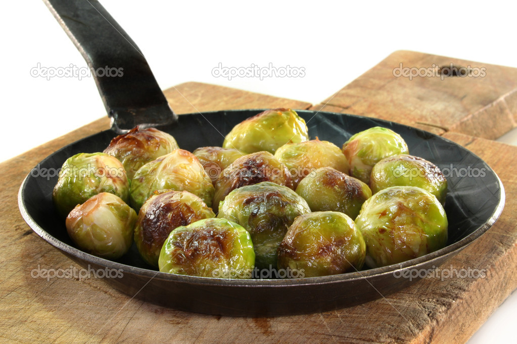 Roasted brussels sprouts on white background — Stock Photo #4320844
