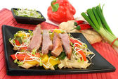 Duck breast with fried noodles — Stock Photo