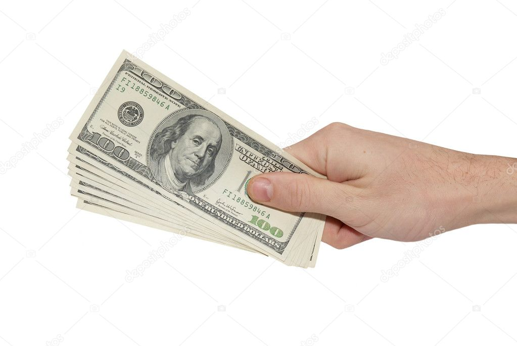 Hand with american dollars isolated on white.  Stock Photo #4349120