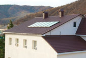 Solar panel (geliosystem) on the house roof. — Stock Photo