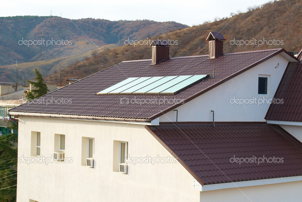 Solar panel (geliosystem) on the house roof. — Stock Photo #4410245