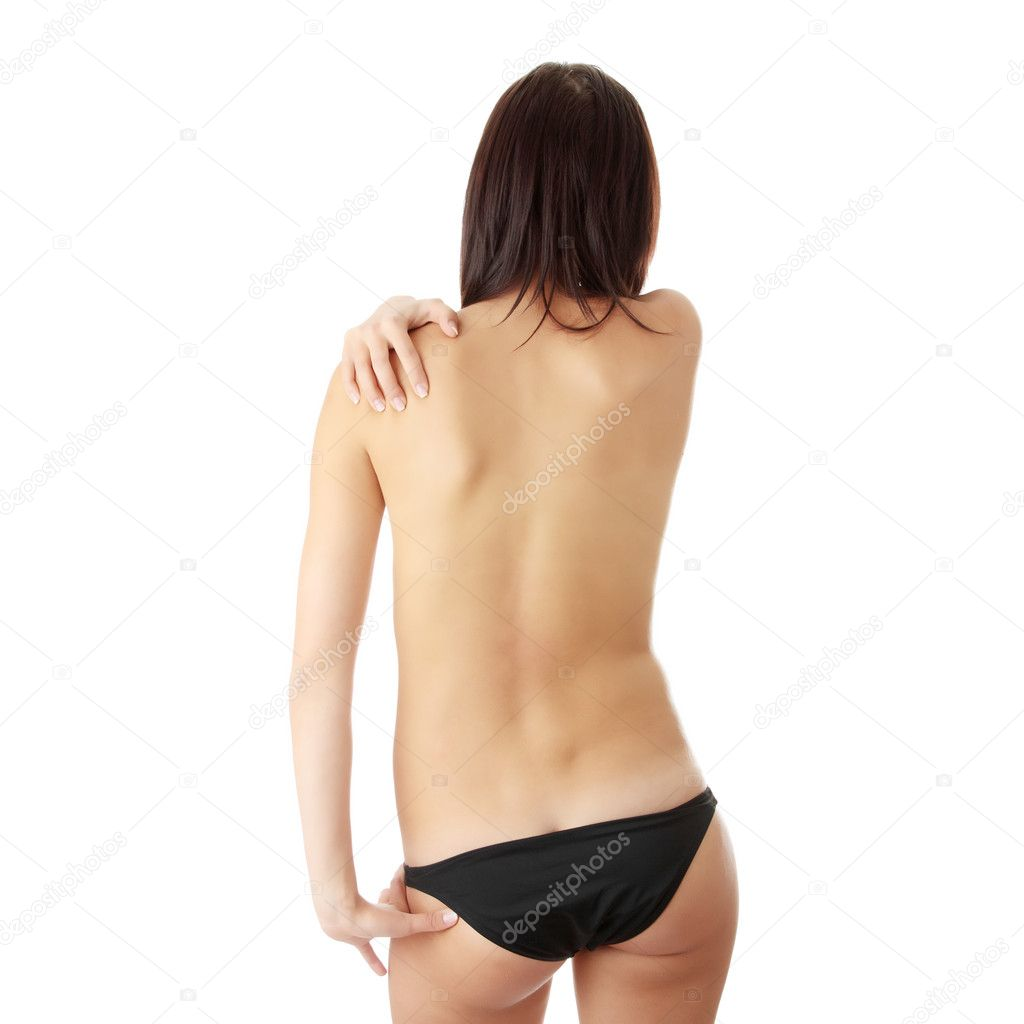 Nude woman from behind. Back pain concept. Isolated — Stock Photo #4821014