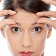Woman with the wrinkles on her forehead — Stock Photo #4833156