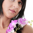 Beautiful Caucasian woman and orchid — Stock Photo #4834018