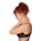 Woman massaging pain in her neck — Stock Photo