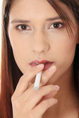 Young woman smoking electronic cigarette — Stock Photo