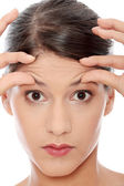 Woman with the wrinkles on her forehead — Stock Photo