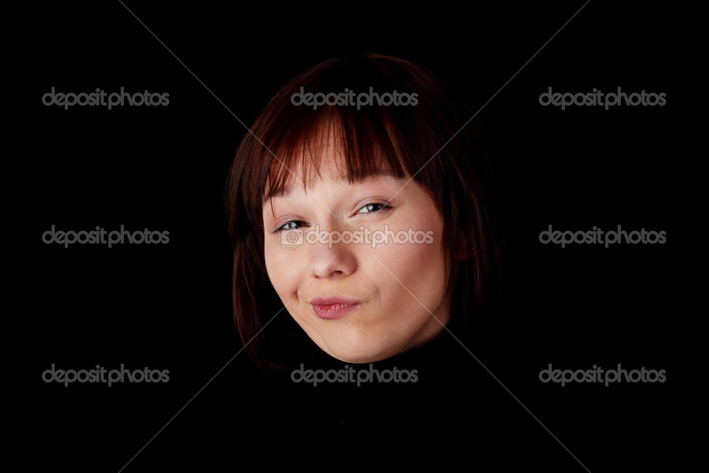 Close up portrait of happy young caucasian woman isolated on black background  Stock Photo #4833337