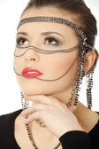 Beutiful brunette with jewelery on her face — Stock Photo