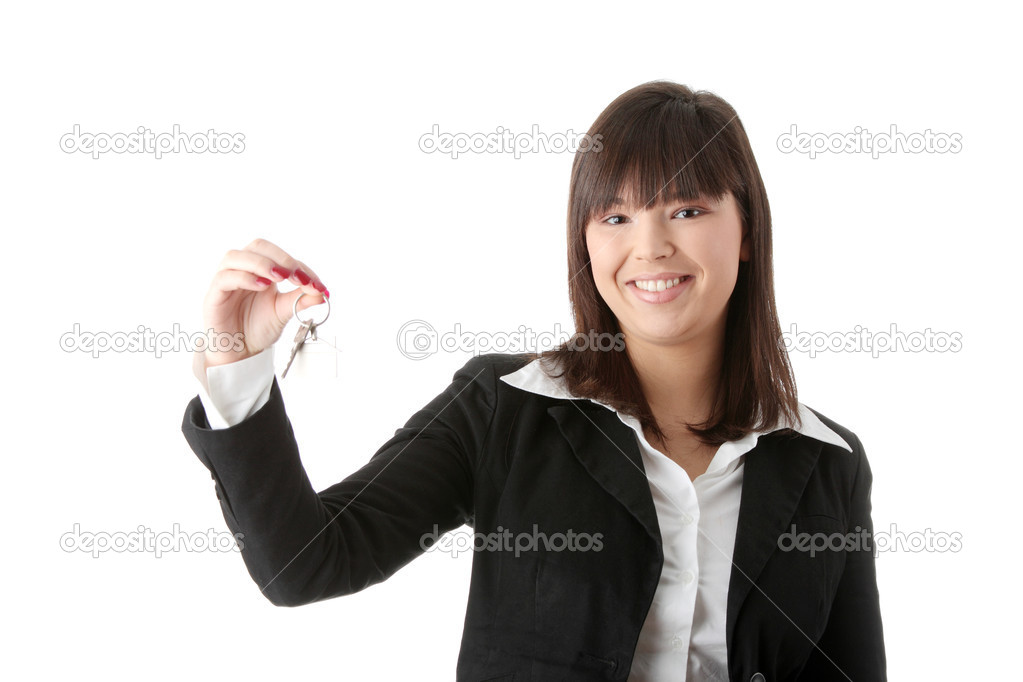 Young businesswoman (real estate agent) with key — Stock Photo #4846922