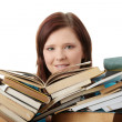 Young woman behind books — Stock Photo