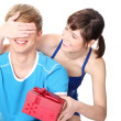 Girl give a gift to her boyfriend. - Stock Photo